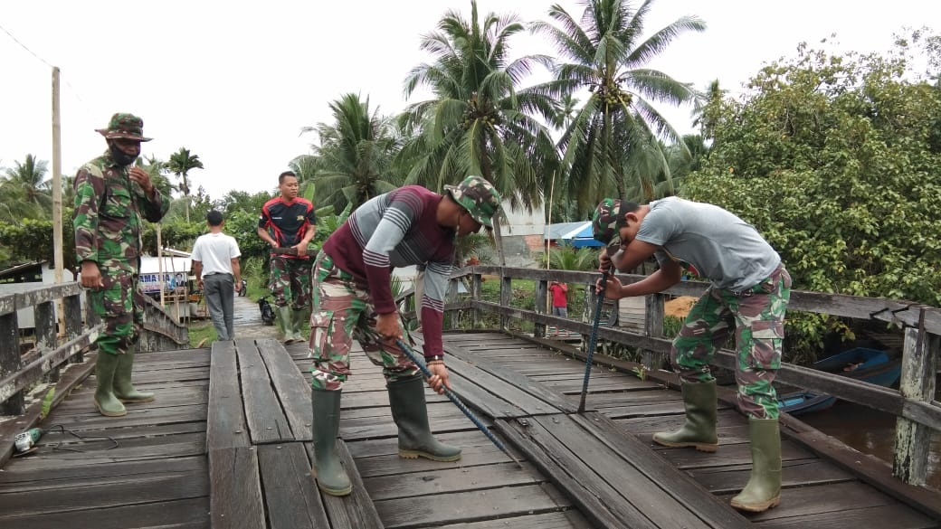 KEDISIPLINAN TNI JADI CONTOH BAGI WARGA 1
