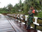 TNI BANGGA TMMD MEMBAWA MANFAAT BAGI MASYARAKAT 13