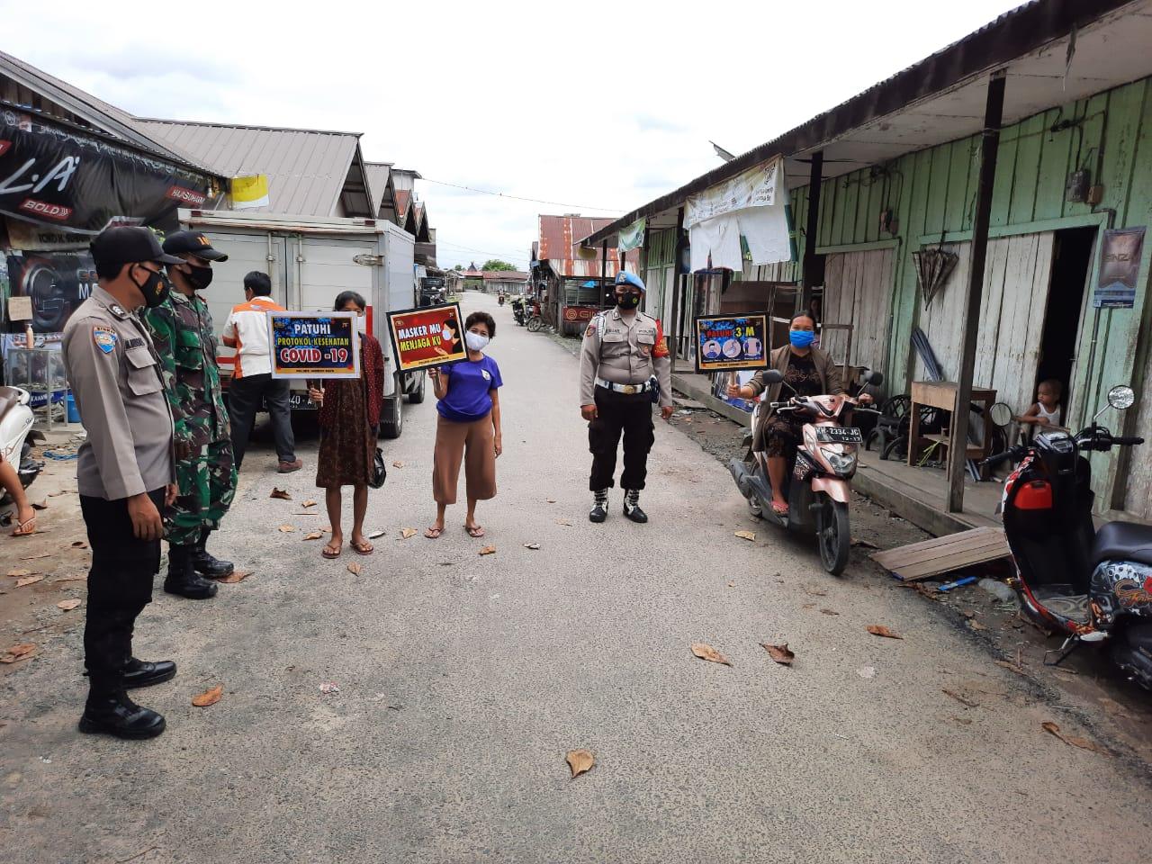 POLSEK JABIREN RAYA BERSAMA TNI TERUS GALAKKAN PENDISIPLINAN PROKES KE MASYARAKAT 1