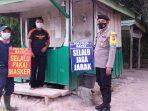 BHABINKAMTIBMAS POLSEK LAMANDAU SAMBANGI POS SECURITY INGATKAN PATUHI PROTOKOL KESEHATAN 2